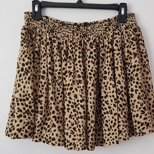H&M Skirts - H&M US size 12 Leopard print mini swing skirt